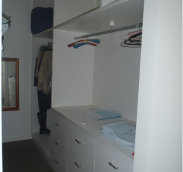 Laminated Walk In Robe With Draws And Hanging Rail
