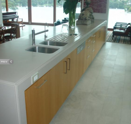 Rift Cut American Oak Veneer Kitchen Island With Stone Surrounds And Undermount Sink