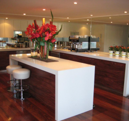 Timber Jarrah kitchen with 80mm benchtops & mirror splashbacks